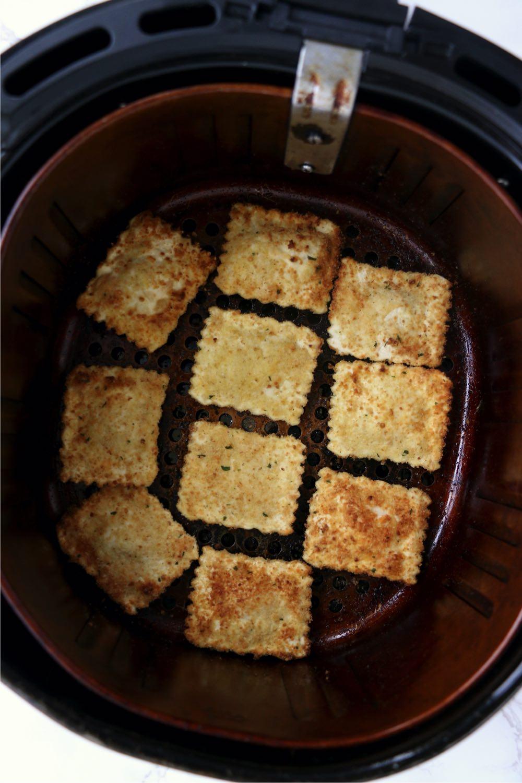 Toasted cheese ravioli in air fryer basket