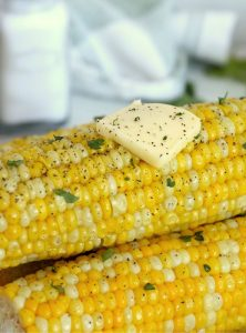 A stack of corn with a pat of butter on top