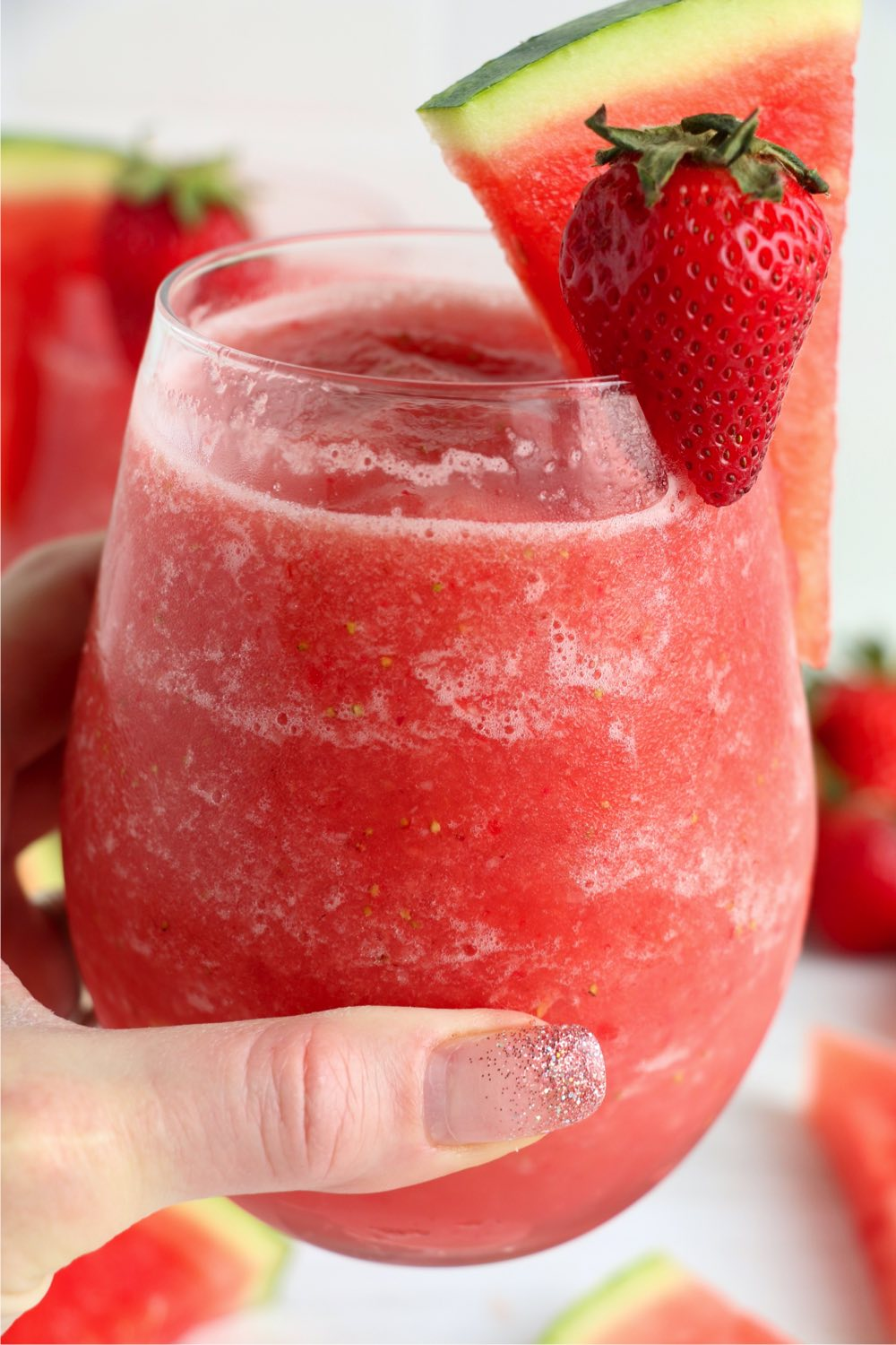 hand holding a frozen strawberry drink