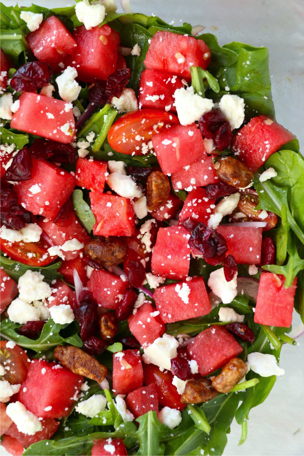 watermelon, feta and greens in a salad