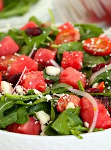 bowl of greens, watermelon, onions and feta cheese