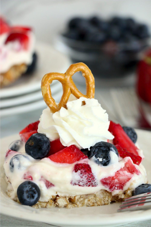 berry dessert with pretzel for garnish