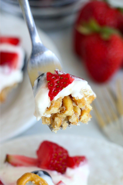 forkful of berry pretzel dessert