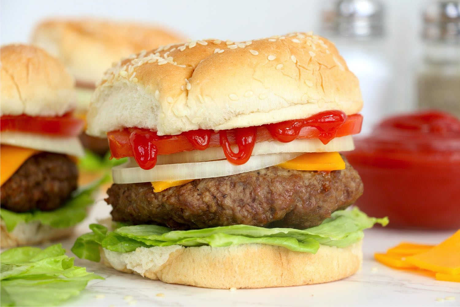 Burgers topped with ketchup