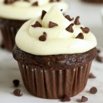close up of chocolate frosted cupcakes